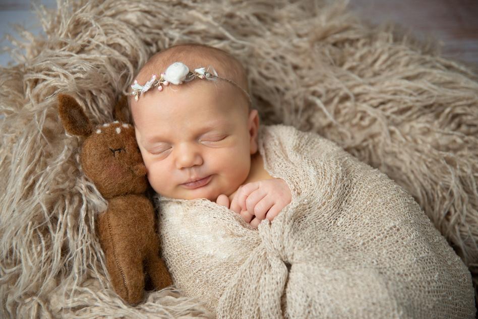 Liebevolle Babyfotografie So kleine Hände